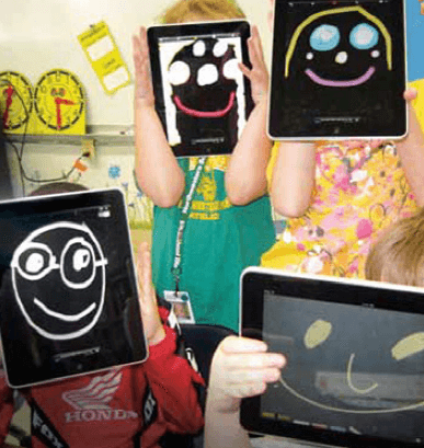 Four children using tablets to draw faces