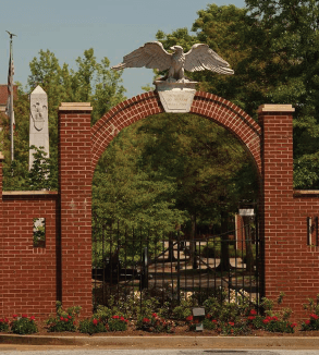 Brick arch with an eagle sculpture on top