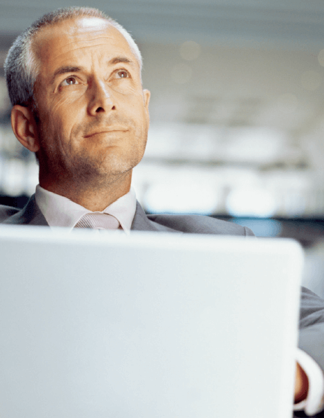 Businessman with laptop, thinking