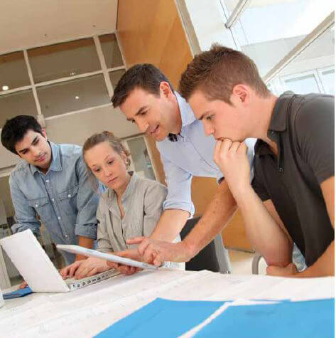 Four businesspeople working together