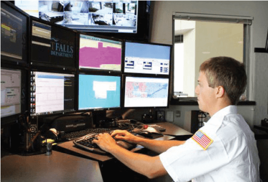 Security officer observing eight computer screens