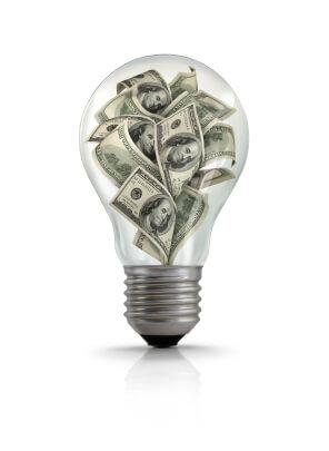 Illustration of American one hundred dollars bills inside lightbulb