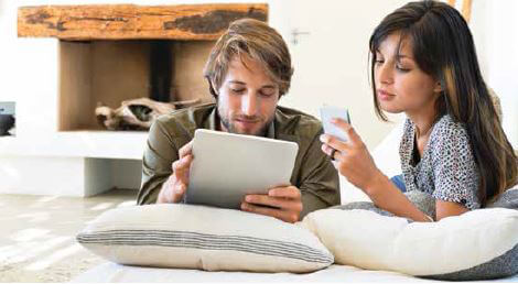 Man and woman holding mobile devices
