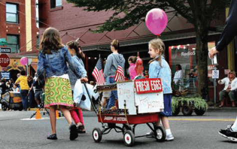 Children pulling a wagon of fresh eggs