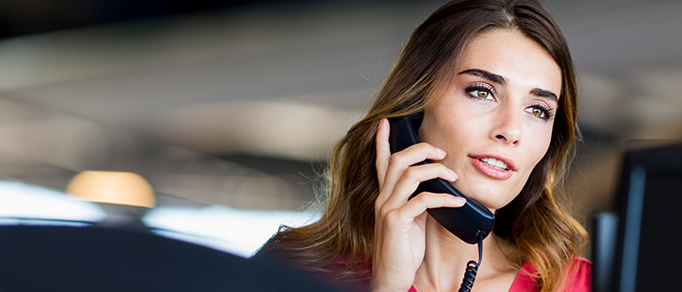 Woman talking on a business phone