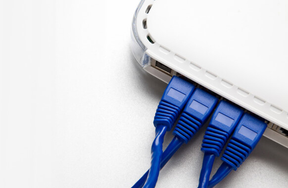 Blue Ethernet cables plugged in