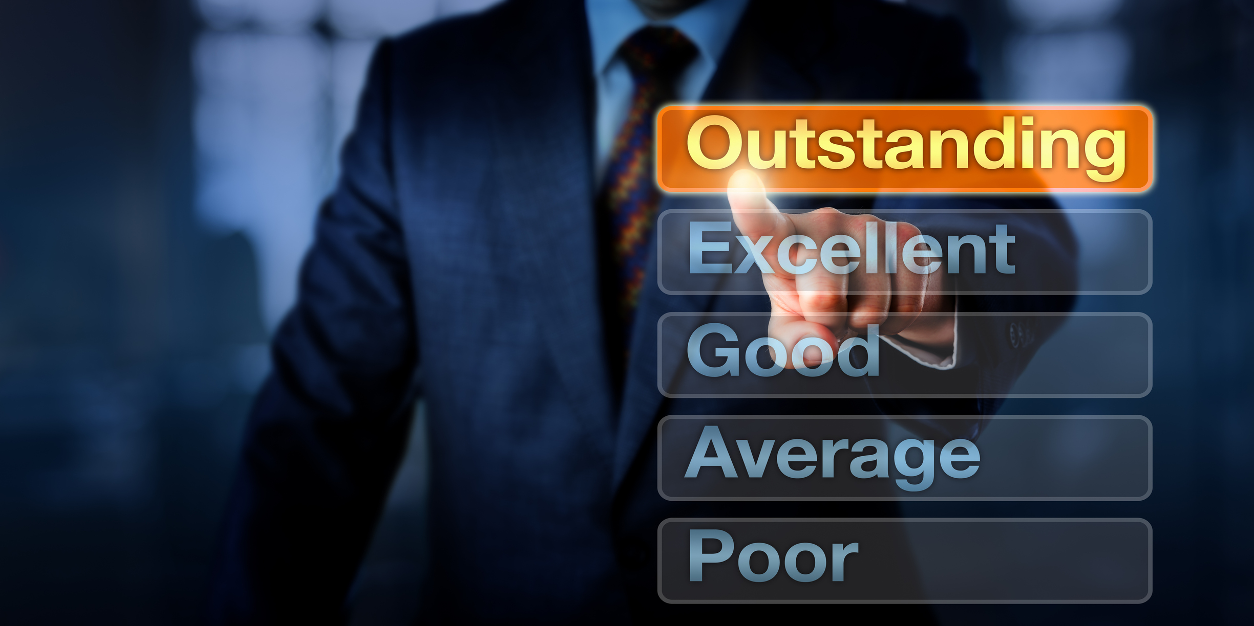 Man pointing to the word outstanding in a list including excellent, good, average, and poor
