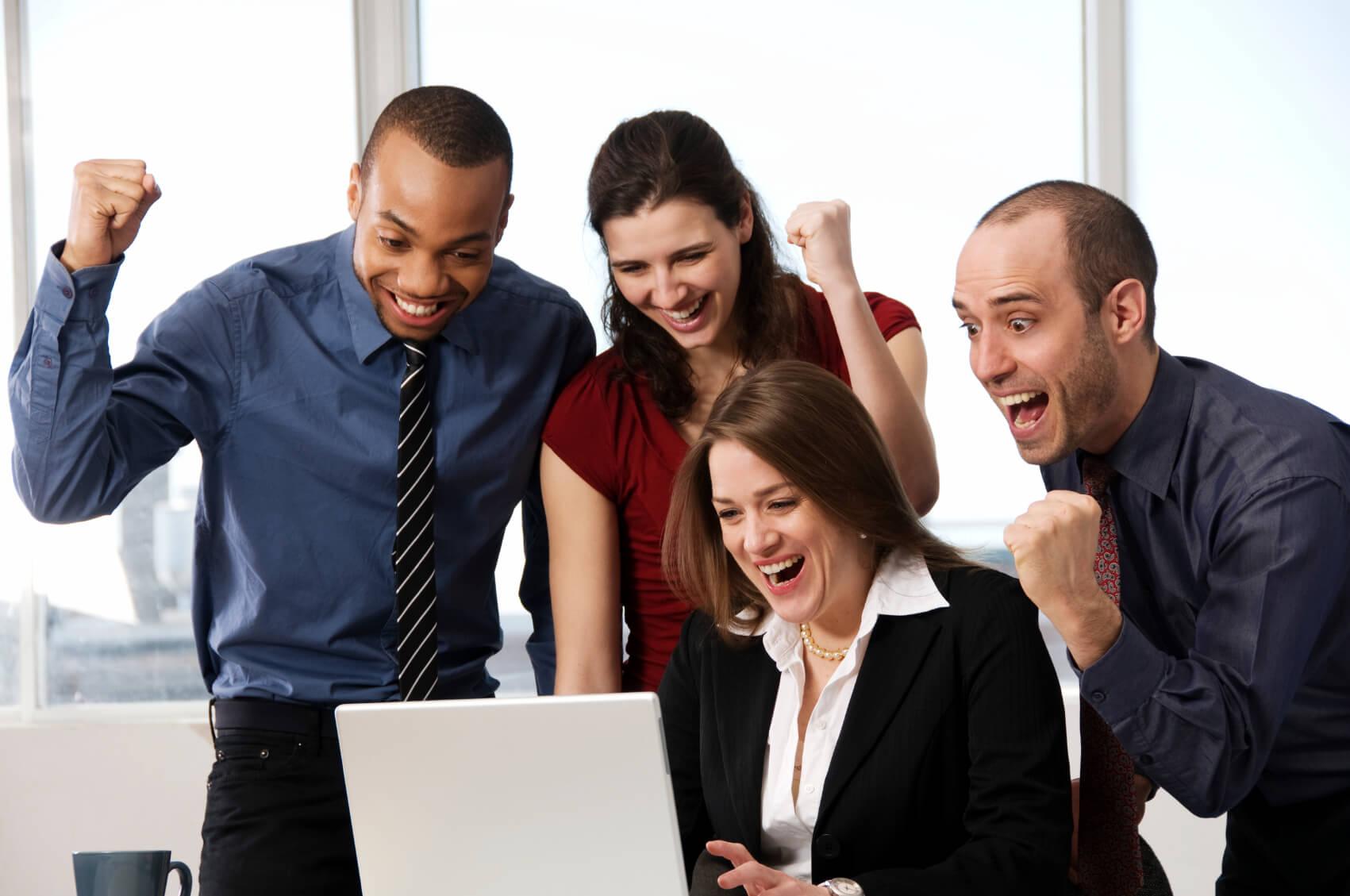 Four business associates celebrating together