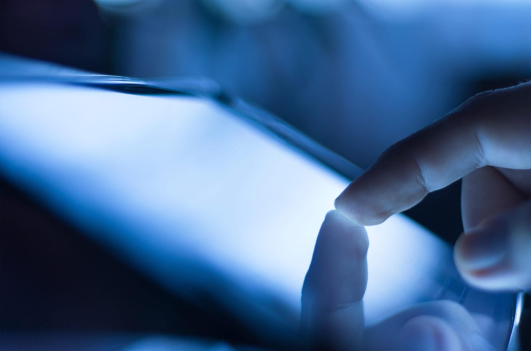 Finger touching digital screen