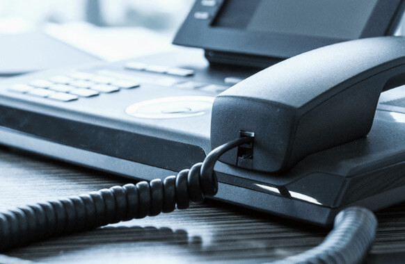 Business phone on an office desk